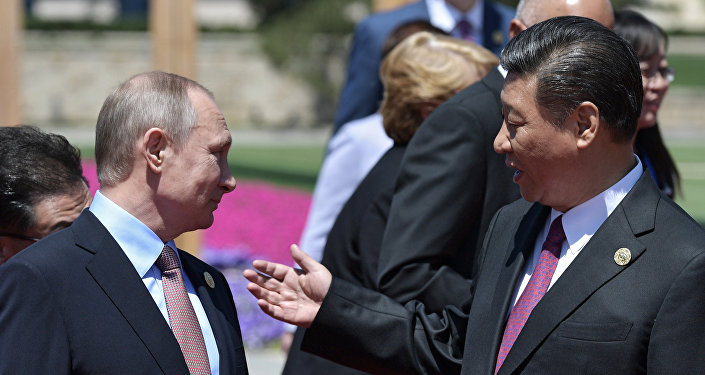 Vladímir Putin, presidente de Rusia, y Xi Jimpin, presidente de China