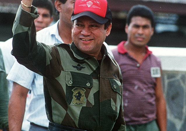 A photo taken 04 October 1989 shows former Panamanian strongman General Manuel Noriega waving as he left his headquarters in Panama City following a failed coup against him