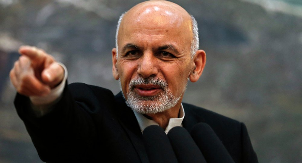 Afghanistan's President Ashraf Ghani points while speaking during a news conference in Kabul