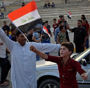 Iraquíes celebrando la liberación de Mosul, Irak