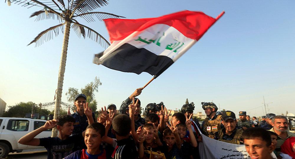 Iraquíes celebrando la liberación de Mosul, Irak (archivo)
