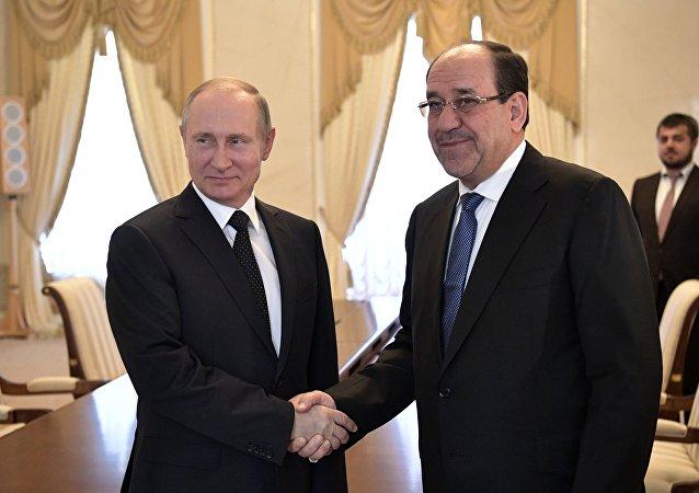 El presidente de Rusia, Vladímir Putin con el vicepresidente iraquí, Nouri Maliki
