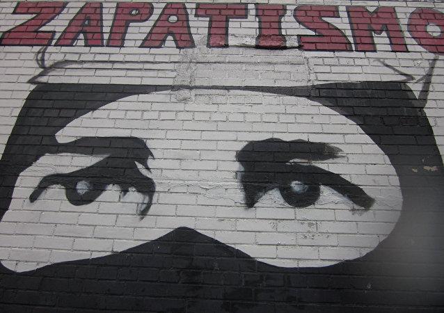 Mural con dibujo zapatista