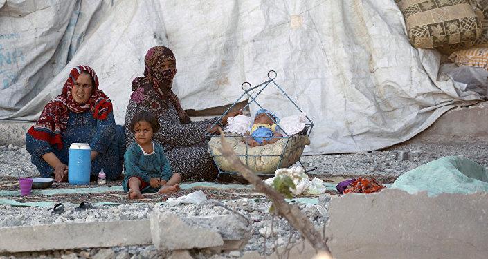 Civiles en Al Raqa