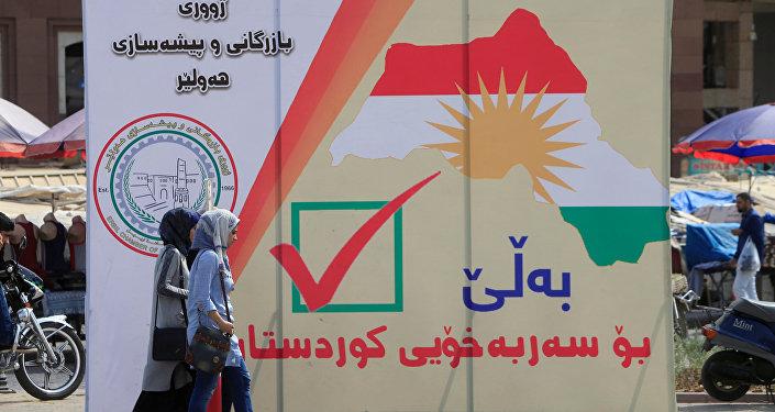 Un cartel con la fecha del referéndum en el Kurdistán iraquí