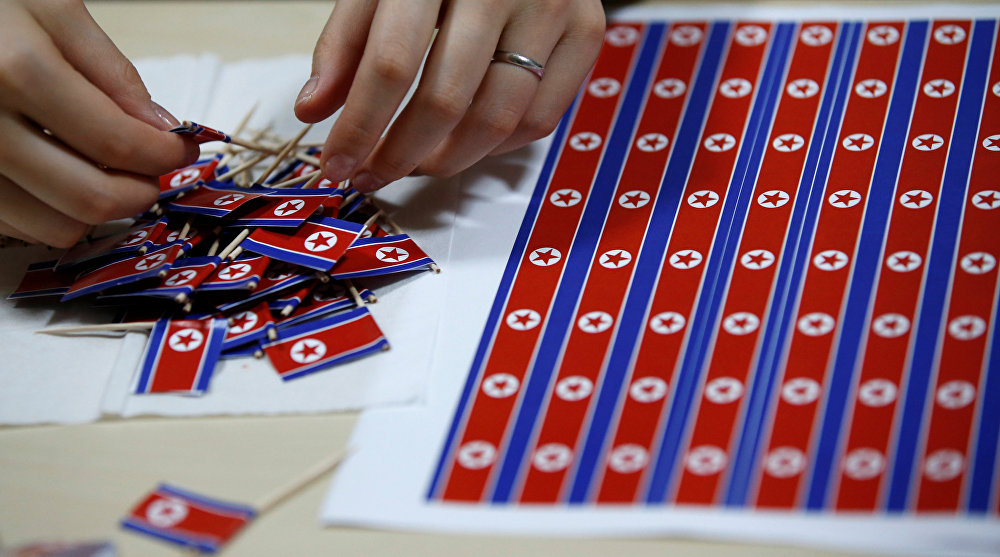A member of Japan's North Korea fan club called sengun-joshi, or military-first girls, makes toothpick North Korean flags in Tokyo, Japan October 29, 2017
