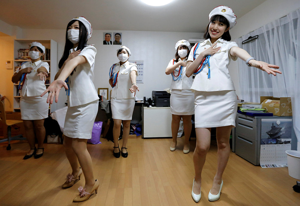 Chunhun (R), the leader of Japan's North Korea fan club called sengun-joshi, or military-first girls, and other members practice a Moranbong Band dance in Tokyo, Japan October 29, 2017