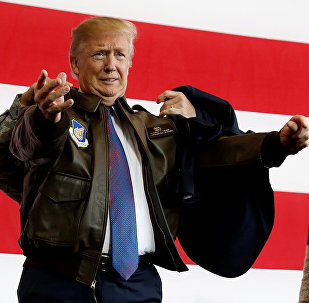U.S. President Donald Trump puts on a U.S. Pacific Air Forces bomber jacket before delivering remarks to members of the U.S. military at Yokota Air Base, Japan November 5, 2017.