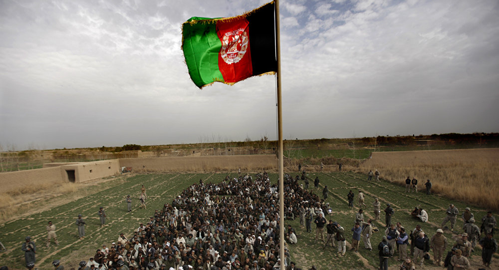 The Afghan national flag is hoisted during an official flag raising ceremony in Marjah on February 25, 2010.