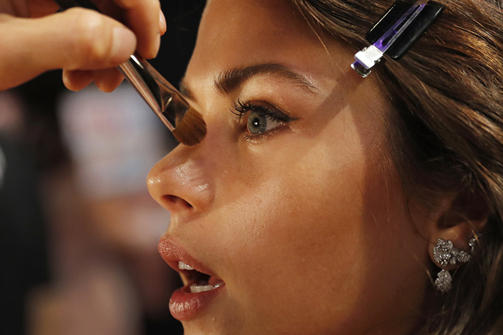 Model Georgia Fowler of New Zealand is made up at backstage before the Victoria's Secret fashion show inside the Mercedes-Benz Arena in Shanghai, China, Monday, Nov. 20, 2017