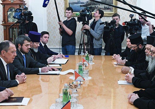 Serguéi Lavrov, ministro de Asuntos Exteriores de Rusia y el Patriarca de Antioquía y de todo el Oriente, Juan X