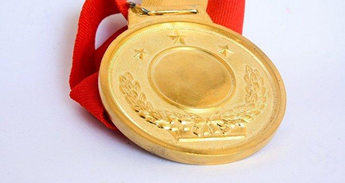Una medalla de oro, imagen referencial