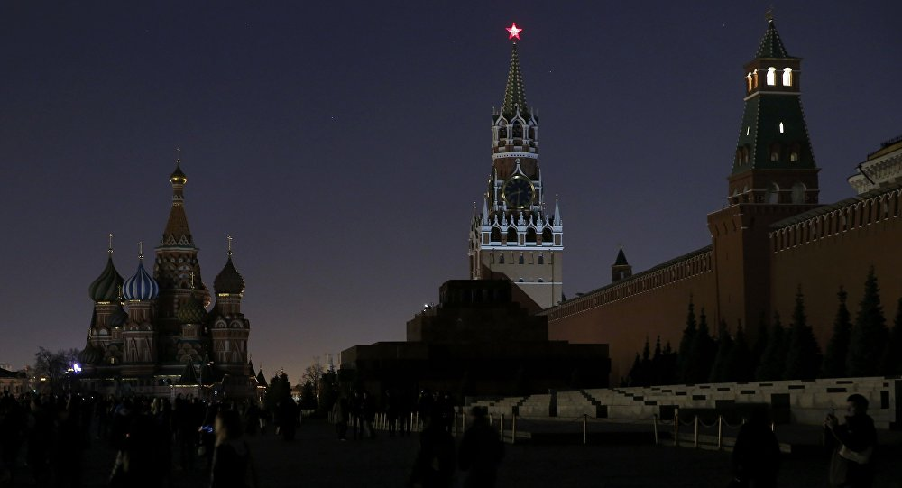 A view shows the St. Basil's Cathedral (L) and the Kremlin wall, after the lights were switched off for Earth Hour in Red Square in central Moscow, Russia