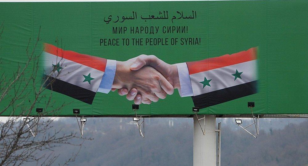 Cartel con la emblema del Congreso del Diálogo Nacional en Sochi