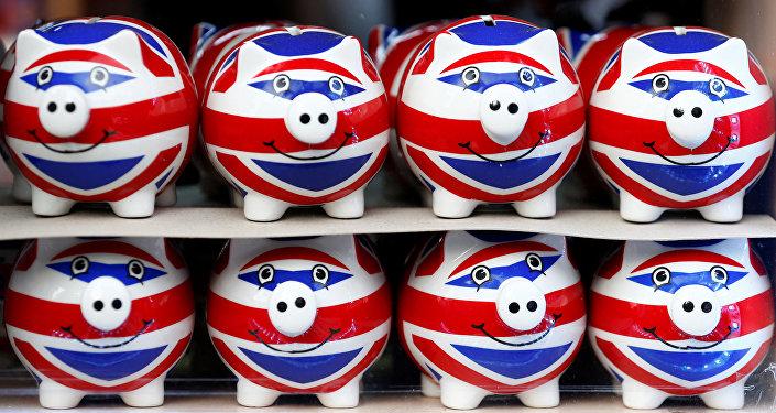 Unos cerditos de porcenala con la bandera del Reino Unido (imagen referencial)
