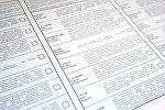 Un boletín con los candidatos para las elecciones presidenciales de 2018 en Rusia