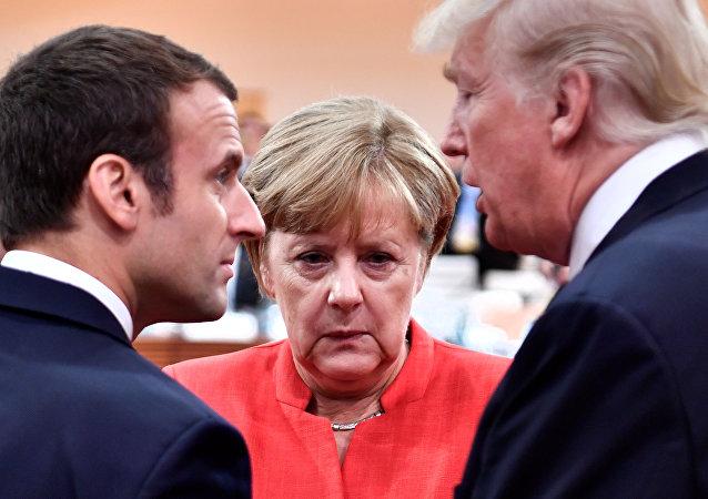 El presidente francés, Emmanuel Macron; la canciller alemana, Angela Merkel, y el presidente estadounidense, Donald Trump