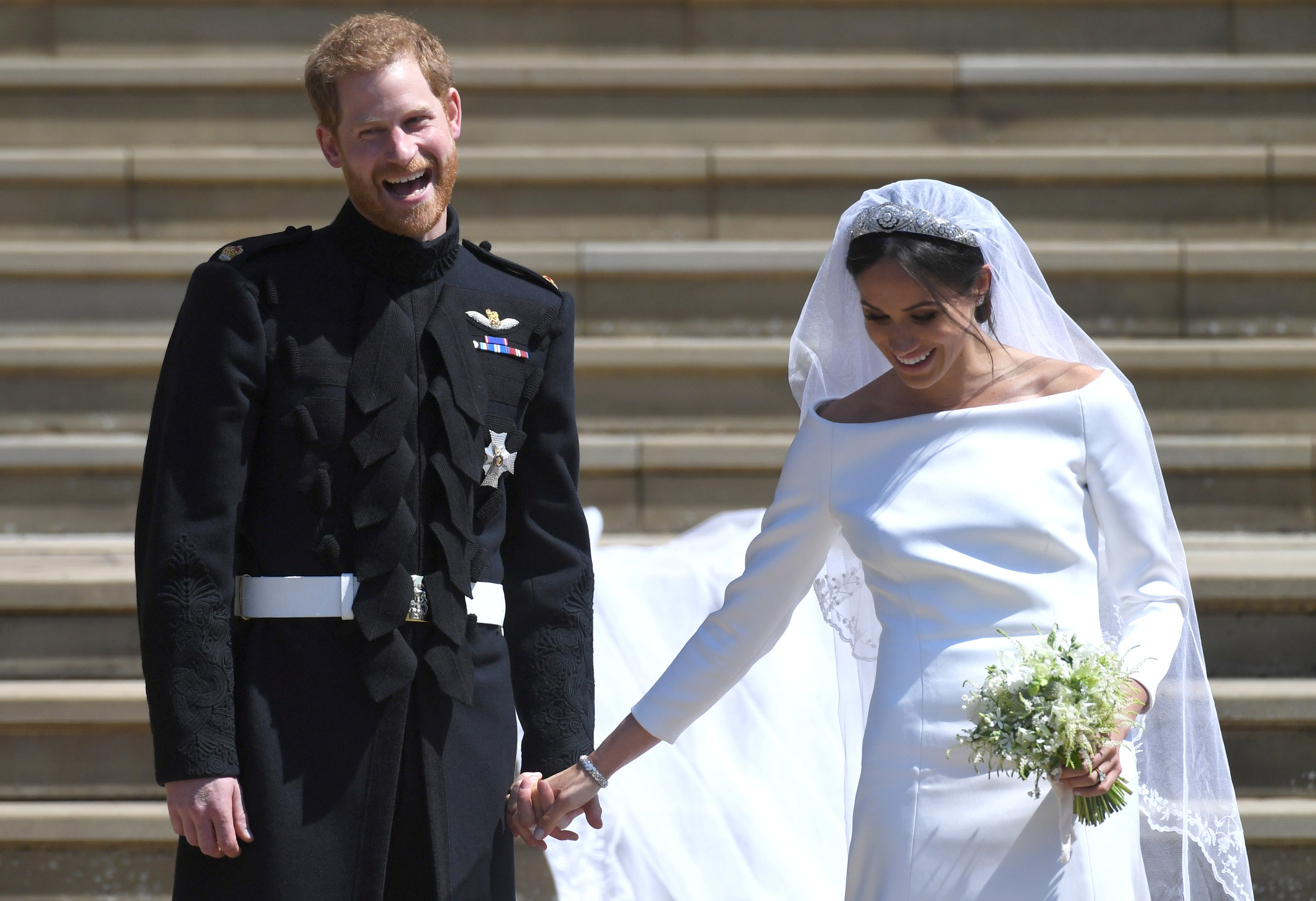 El príncipe Harry con su esposa, Meghan Markle