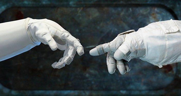 Las manos de dos astronautas