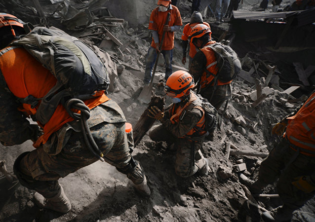 Soldiers search for remains at an area affected by the eruption of the Fuego volcano at El Rodeo in Escuintla, Guatemala