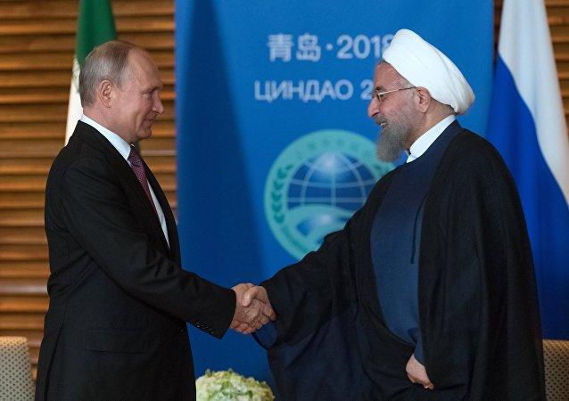 El presidente ruso, Vladímir Putin, durante su reunión con el mandatario iraní, Hasán Rohaní