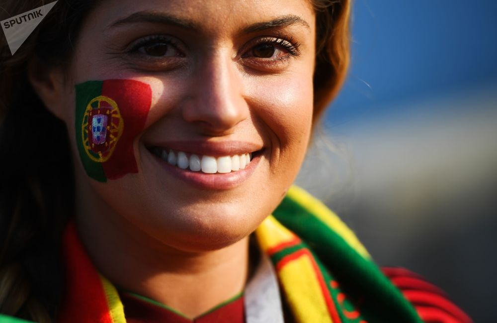 A fan of the Portuguese national team before the start of a group stage match between Portugal and Spain.