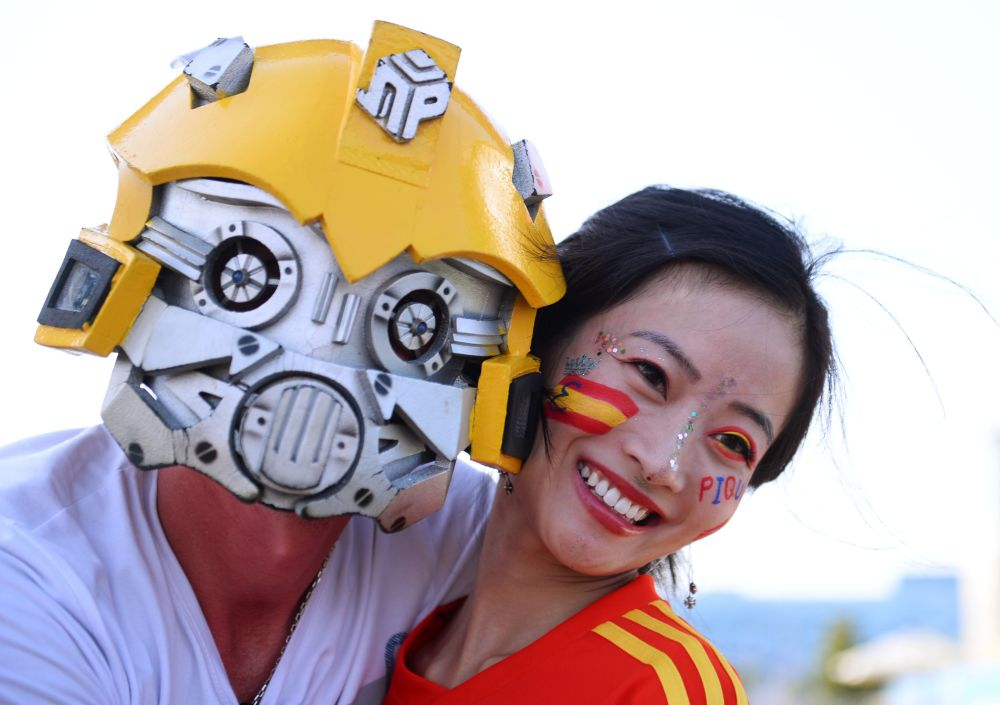 Fans posing for a photo ahead of a group stage World Cup match between Spain and Portugal.