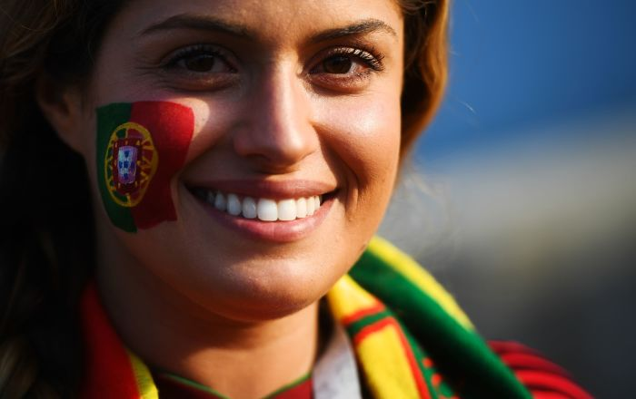A fan of the Portugal national team before the start of a group stage match between Portugal and Spain.