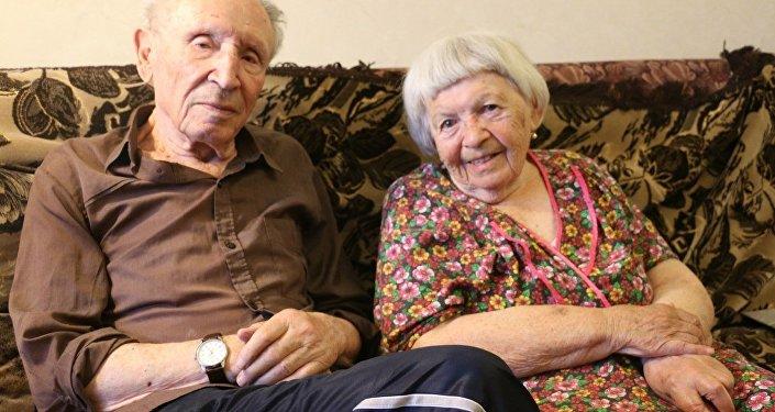 Grigori Merzon con su esposa