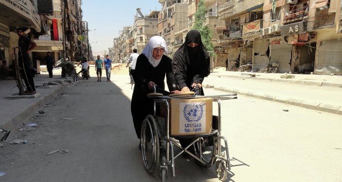 Refugiados palestinos con la ayuda humanitaria de la UNRWA