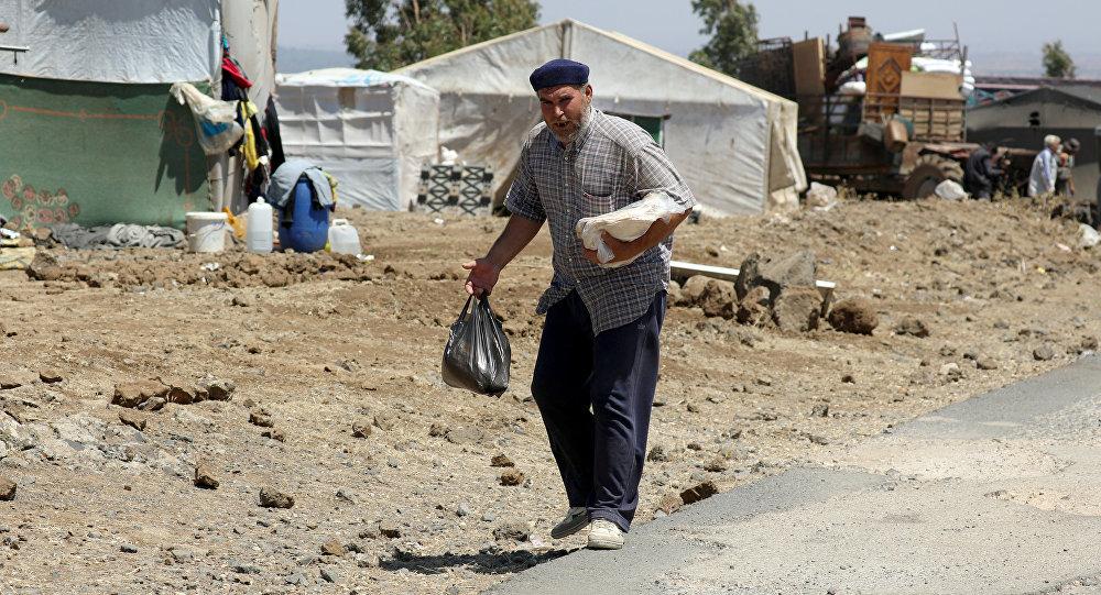 Un desplazado en un campo de refugiados en Siria