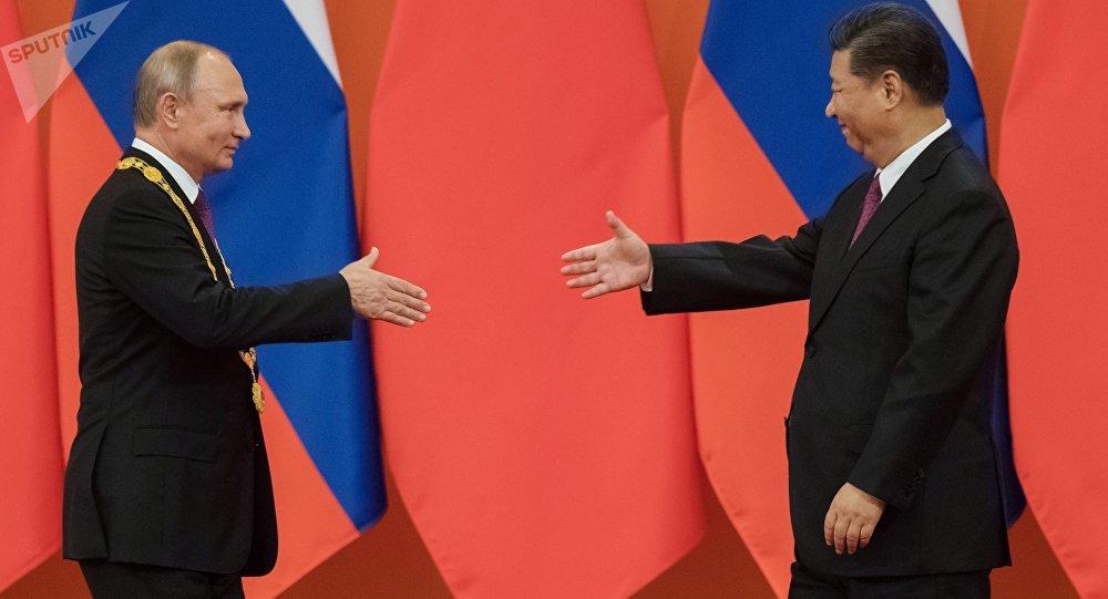 Presidente de Rusia, Vladimir Putin y el presidente de China, Xi Jinping