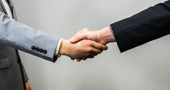Apretón de manos de negocios