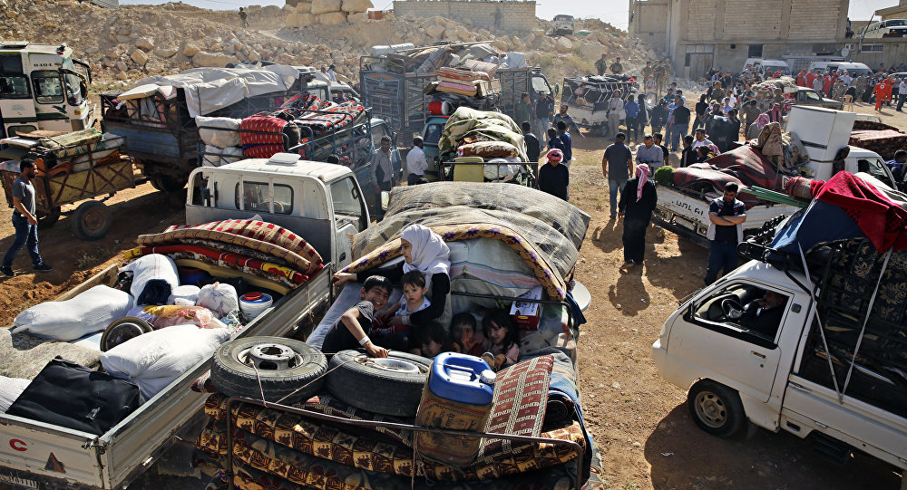 Una caravana de refugiados sirios