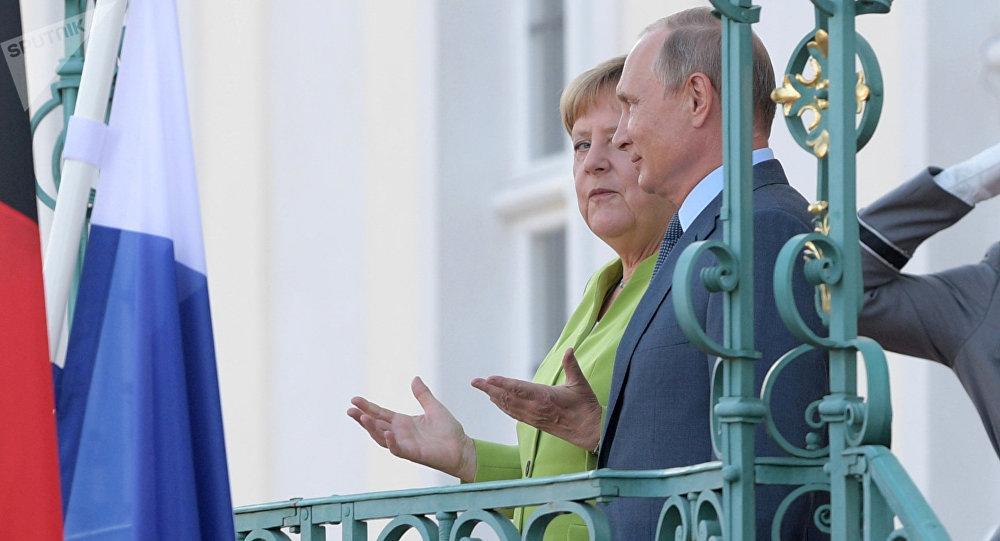 Angela Merkel y Vladímir Putin