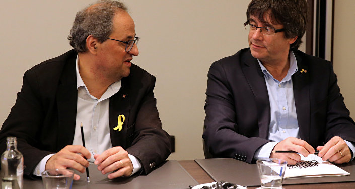 Presidente del Gobierno catalán, Quim Torra, y expresidente de Cataluña, Carles Puigdemont