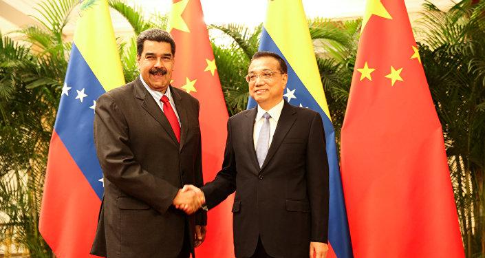 El presidente de Venezuela, Nicolás Maduro, y el primer ministro chino, Li Keqiang en Beijing, China