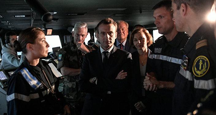 Emmanuel Macron (centro), presidente de Francia