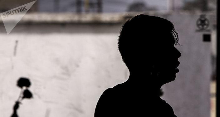 Migrante en uno de los albergues saturados en la ciudad fronteriza