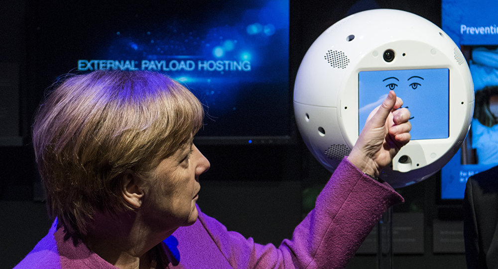 Angela Merkel con el robot CIMON