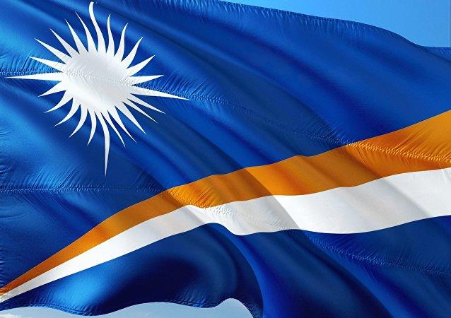 La bandera de las Islas Marshall