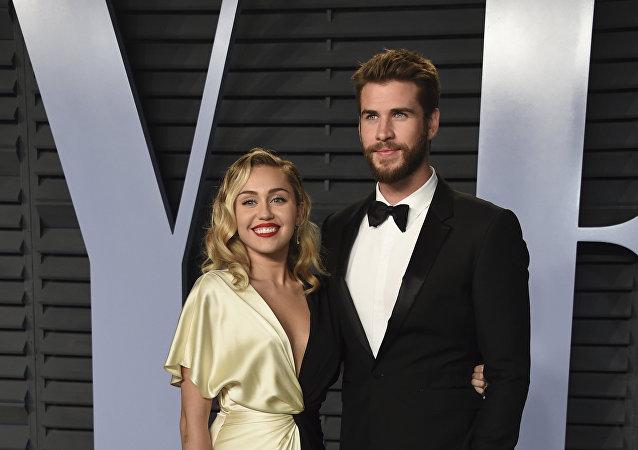 Miley Cyrus, cantante, y su pareja, el actor Liam Hemsworth