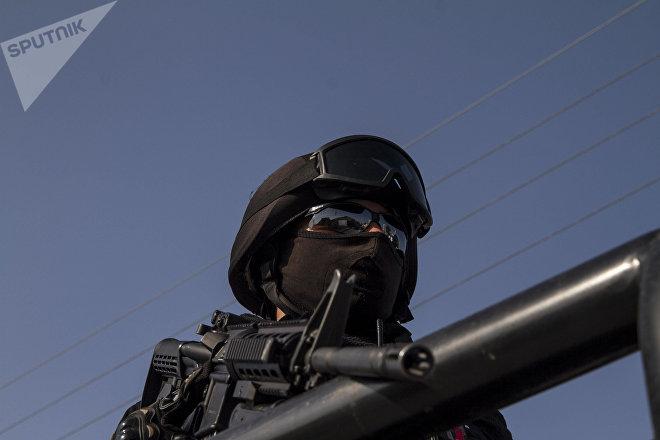 Policía de la corporación GATE en Allende, Coahuila. Las corporaciones policíacas fueron acusadas ante la Corte Penal Internacional de cometer delitos de lesa humanidad.