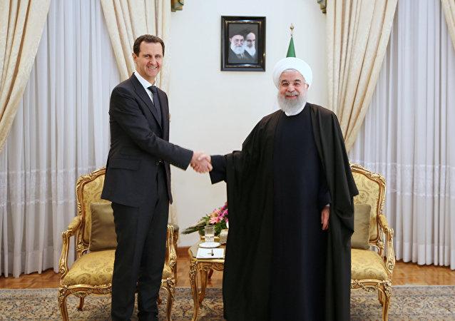 Presidente sirio, Bashar Asad, y presidente de Irán, Hasán Rohaní