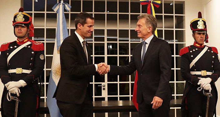 El lider opositor, Juan Guaidó y el presidente de Argentina, Mauricio Macri
