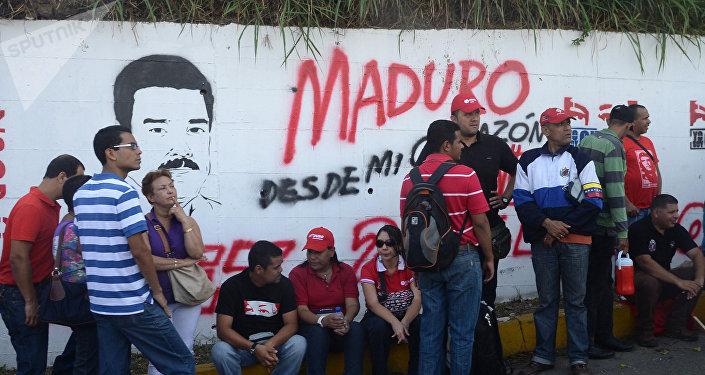 Un cartel recuerda a Hugo Chávez en Caracas