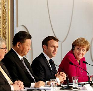 El presidente de la Comisión Europea, Jean-Claude Juncker, el presidente chino, Xi Jinping, el presidente de Francia, Emmanuel Macron, la canciller alemana, Angela Merkel en París, Francia