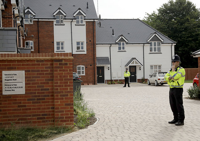British police officers stand outside a residential property in Amesbury, England, Wednesday, July 4, 2018