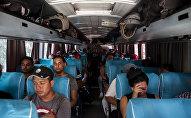 Tapachula, Chiapas. Cubanos en los autobuses que rentaron para salir en el Vía Crucis cubano a la frontera norte