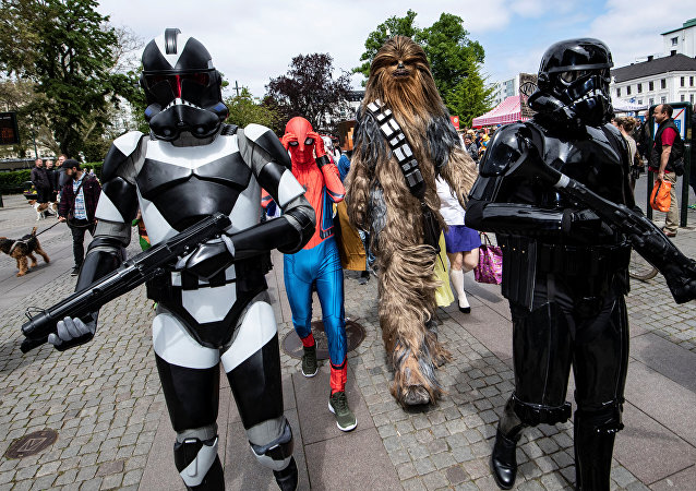 People dressed as Stormtroopers, Spiderman and Chewbacca walk at the Geek Pride Day parade celebrated in Malmo, Sweden May 25, 2019.